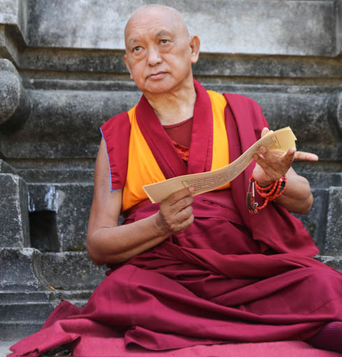 "Lama Zopa Rinpoche reading Lama Tsongkhapa's ""Lekshe Nyingpo,"" Mahabodhi Stupa, Bodhgaya, India, March 2015. Photo by Ven. Thubten Kunsang."