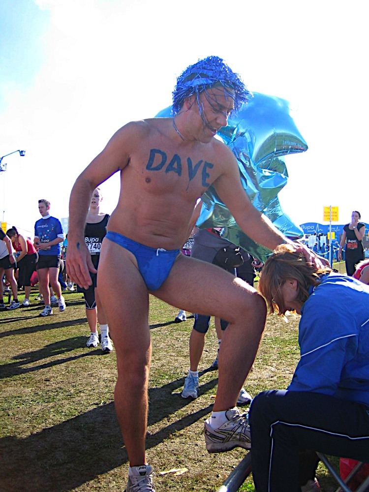 Dave hung on to Louise's head for dear life as she wrestled with his sweaty chip - olata.