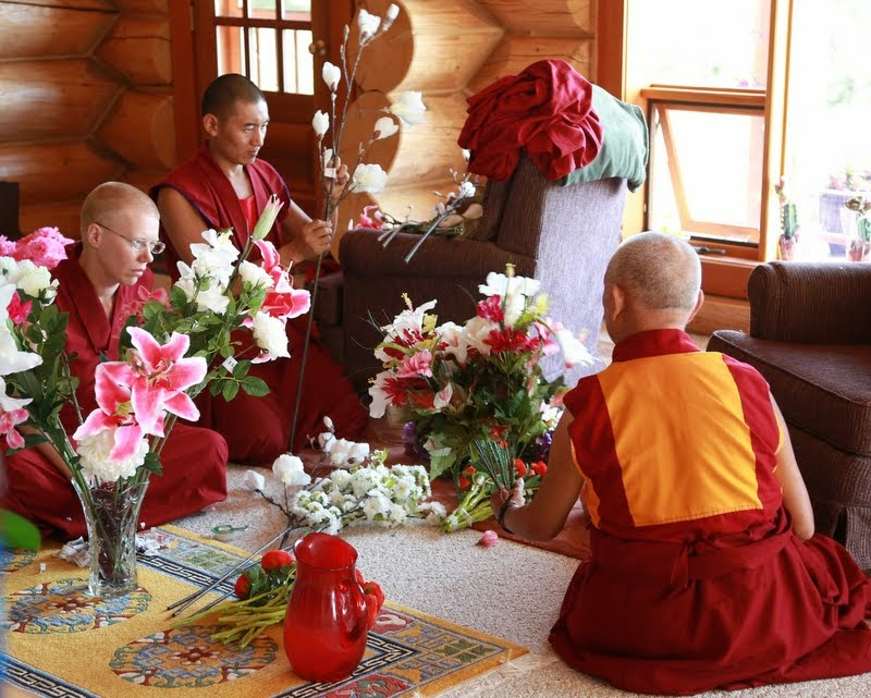 Arranging flower offerings for the Amitabha Buddha statue following Rinpoche's very specific advice, Buddha Amitabha Pure Land, Washington, US, August 2014. Photo by Ven. Thubten Kunsang.