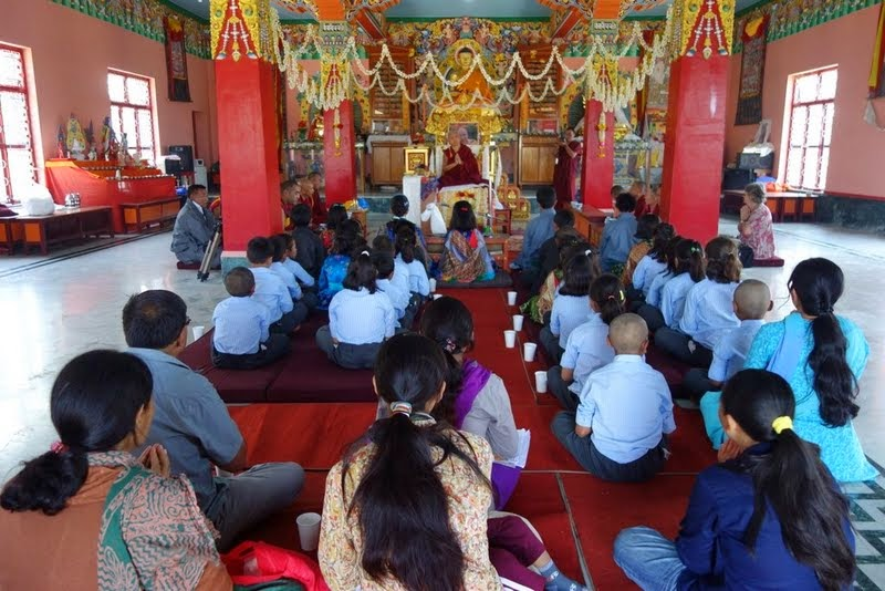 Lama Zopa Rinpoche teaching and giving oral transmissions to children from Ladakh at Sera Monastery, India, January 2014. Photo by Ven. Roger Kunsang.