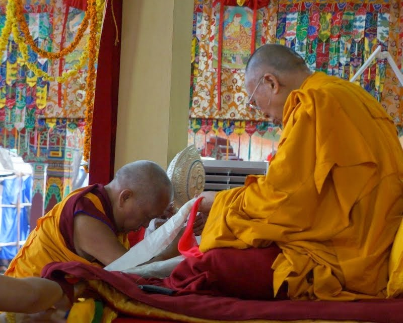 Lama Zopa Rinpoche offering a Dharmachakra to His Holiness the Dalai Lama, Sera Monastery, Bylakuppe, Karnataka, India, January 2, 2014. Photo courtesy of OHHDL.