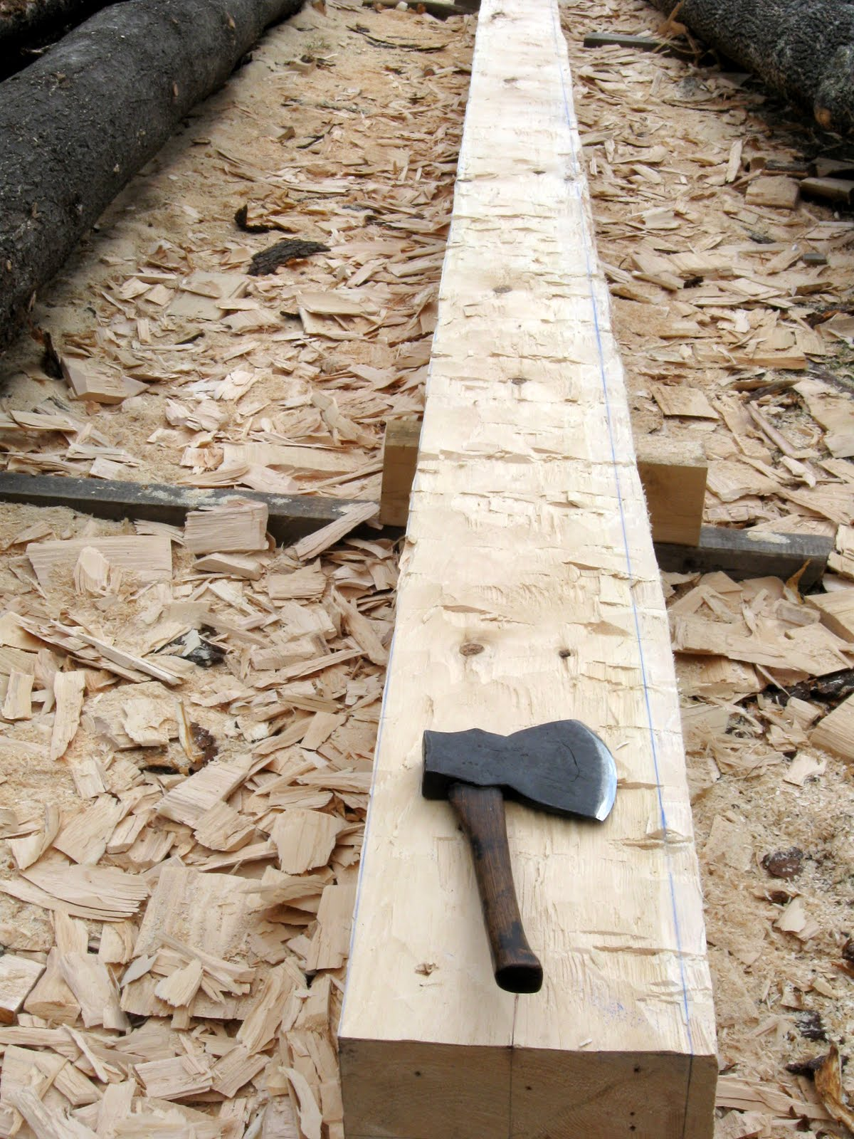 Here is the sill timber with one face left to hew.