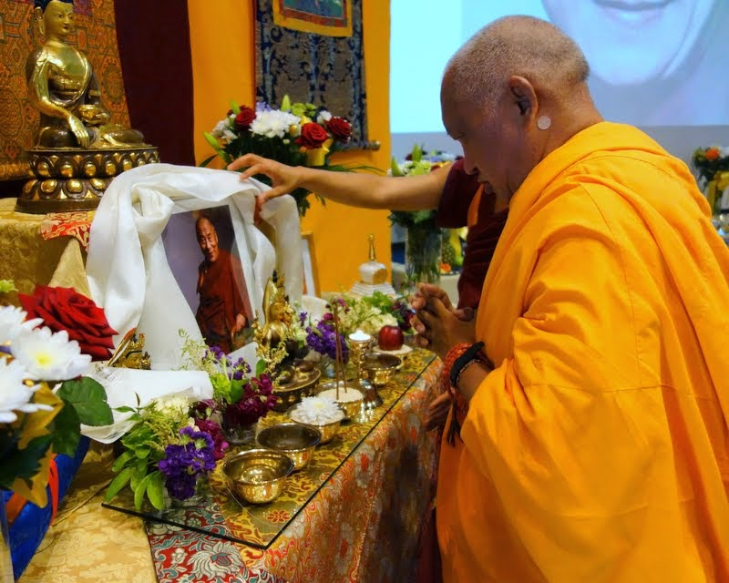 Lama Zopa Rinpoche offering a khata to a photo of His Holiness the Dalai Lama on His Holiness' birthday, Jamyang Buddhist Centre Leeds, UK, July 6, 2014. Photo by Ven. Roger Kunsang.