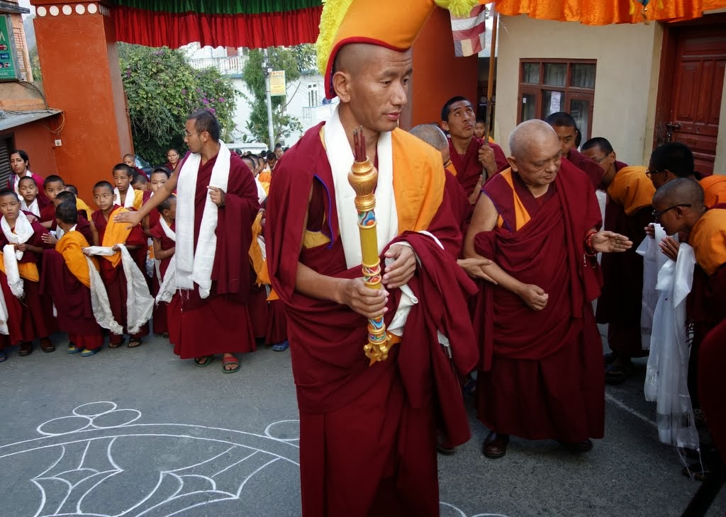 A long line waits to greet Lama Zopa Rinpoche, including more than 200 foreigners who are doing the month-long meditation course, Kopan Monastery, Nepal, November 22, 2013. Photo by Ven. Roger Kunsang.