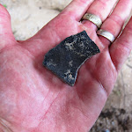 Darkened pottery shard near the cave in Inner Pasture