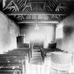 St Mary's Church. The interior in this simple country church looking east from the nave to the chancel. The stone font in the foreground is Norman, while the queen strut roof above is fifteenth century. Henry W Taunt, 1906. Copyright © Oxfordshire County Council Photographic Archive. Reproduced with the kind permission of Oxfordshire Studies. This photograph may be purchased from their Heritage Search web site at http://www.oxfordshire.gov.uk/heritagesearch