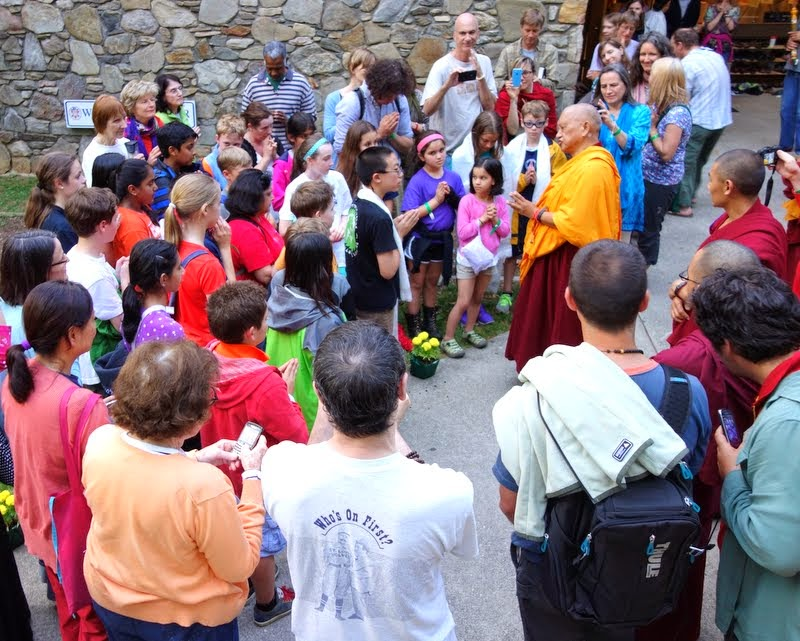 Lama Zopa Rinpche giving an impromptu teaching to children at the YMCA center where Light of the Path is held, Black Mountain, North Carolina, US, May 2014. Photo by Ven. Roger Kunsang.