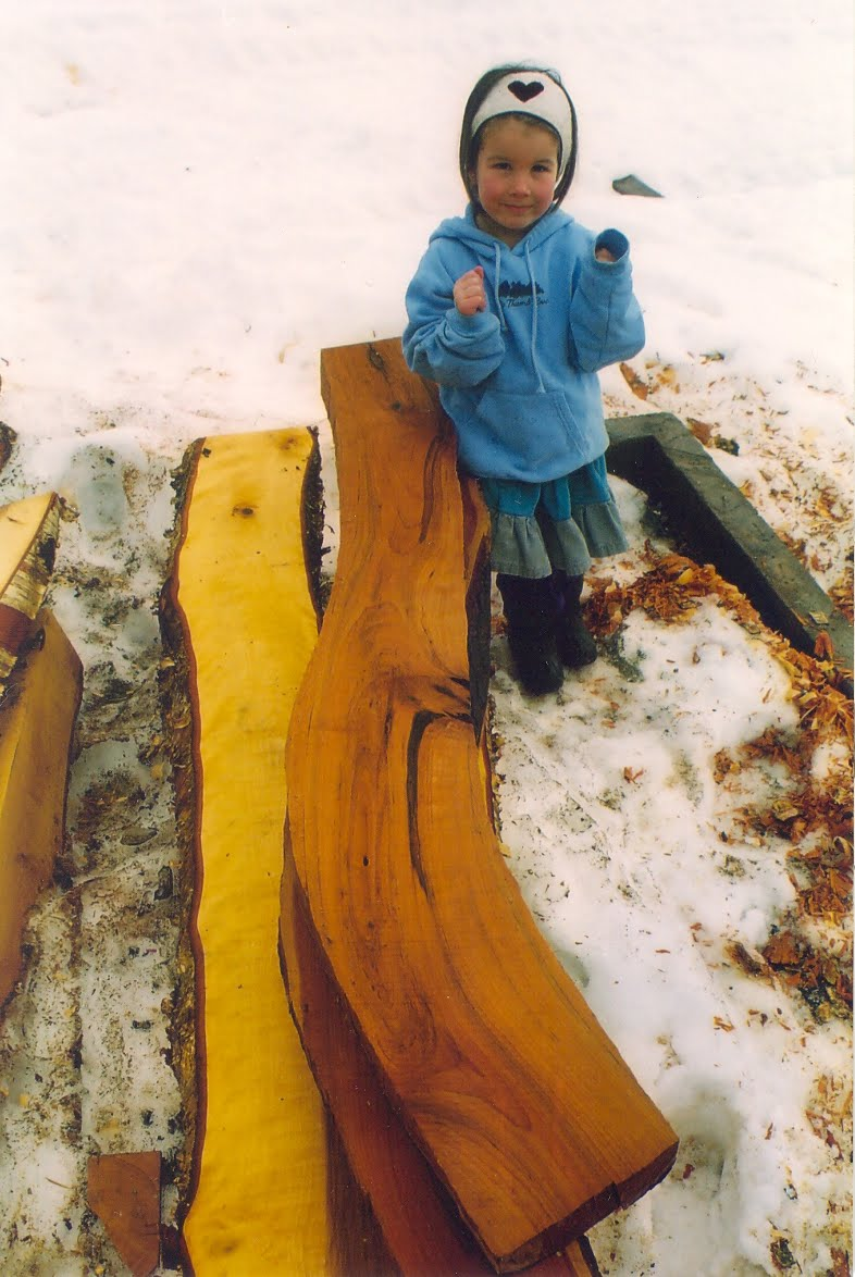Aurora Kelley with some beautiful yellow birch and cherry timbers.