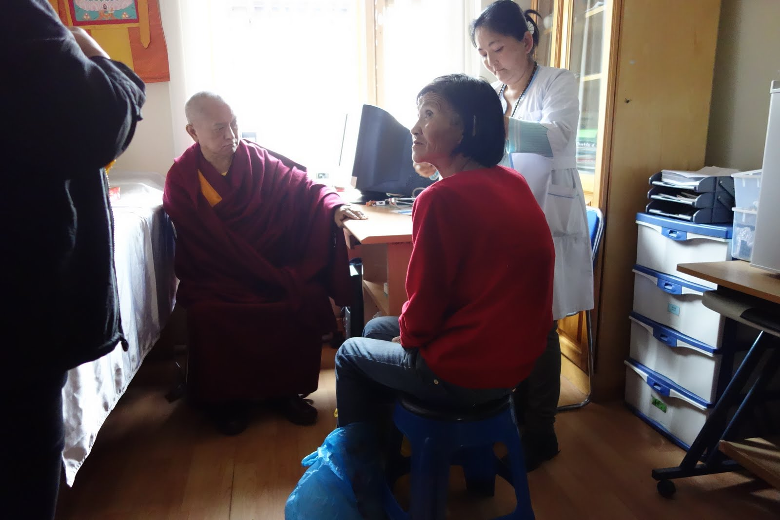 Rinpoche talking with patients at the free health clinic in Ulaan Bataar. Mongolia. September 2013. Photo: Ven. Roger Kunsang