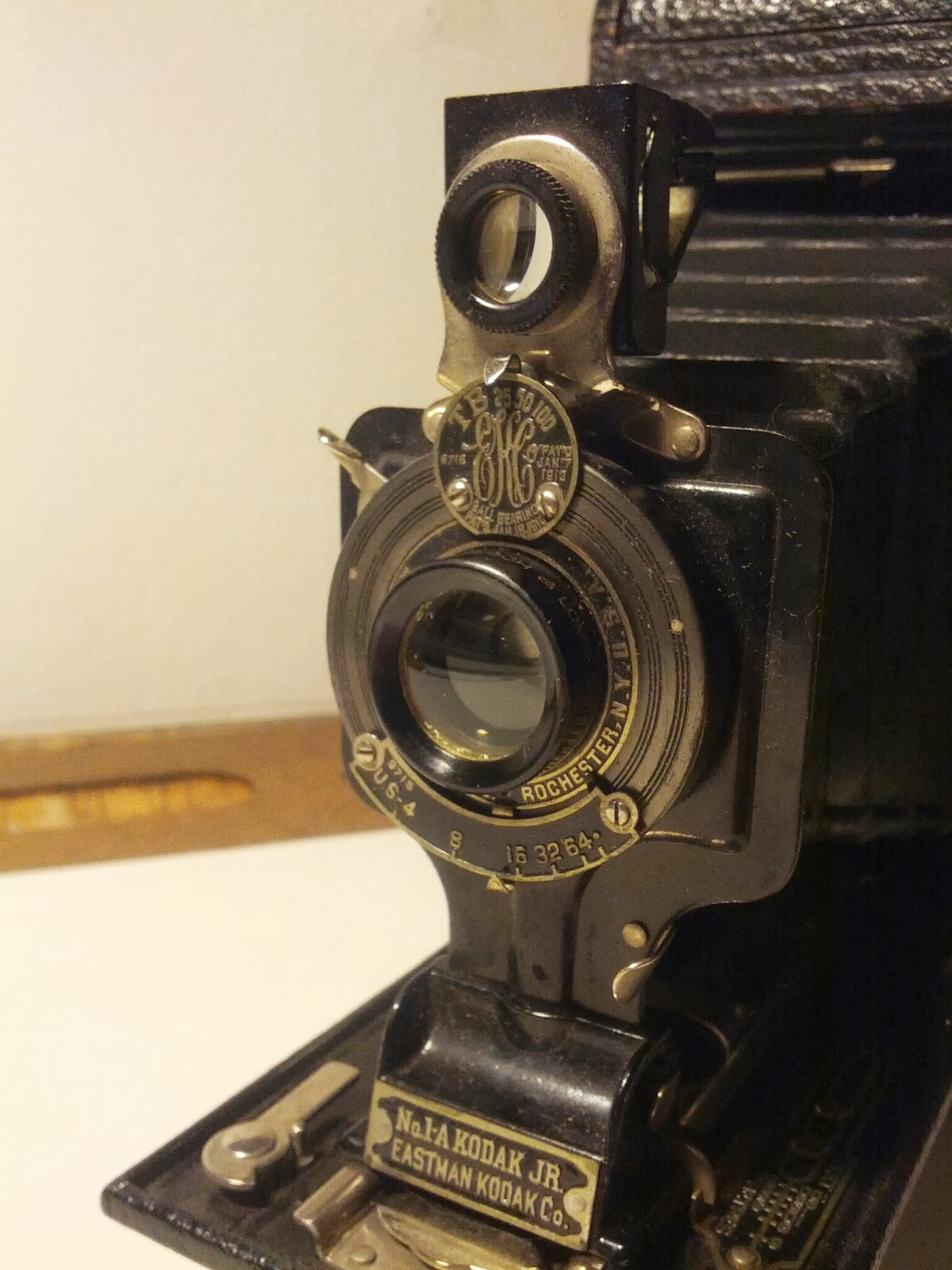 Kodak made this model for like twenty years, in a variety of lenses and shutters.  This one has a Rapid Rectilinear lens by Bausch & Lomb