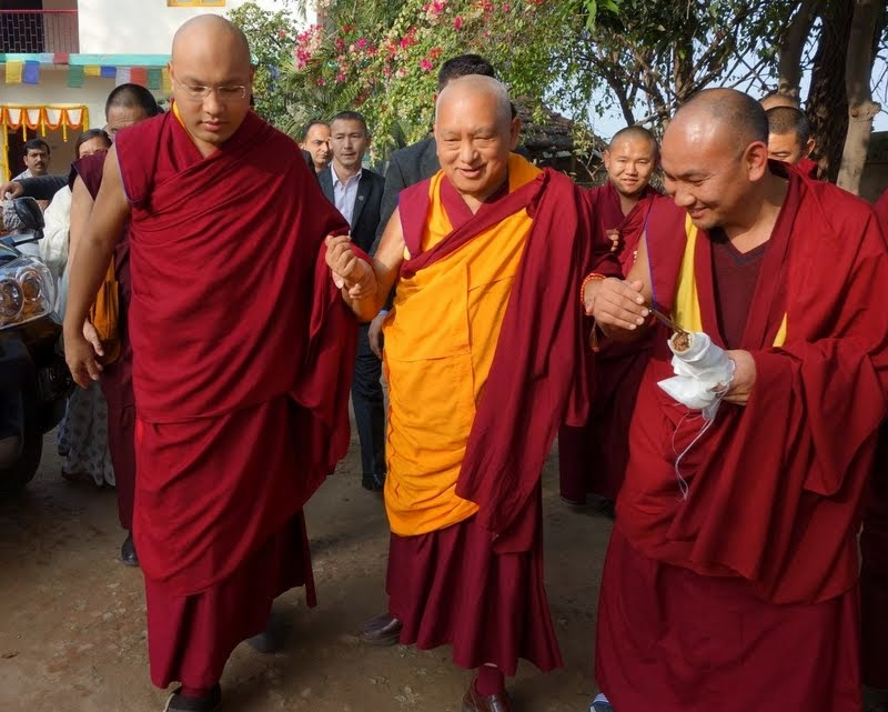 His Holiness the Karmapa and Lama Zopa Rinpoche walking from Maitreya School to Root Institute, Bodhgaya, India, January 2014. Photo by Ven. Roger Kunsang.