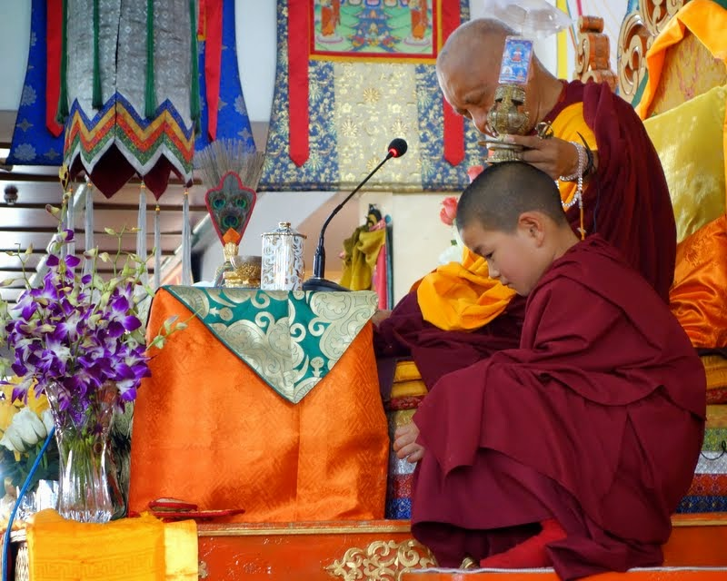 During an Amitayus initiation, Lama Zopa Rinpoche giving the blessing of the vase to a young Mongolian lama who is the 22nd incarnation of a Manjushri manifestation, Ulaanbaatar, Mongolia, August 2014. Photo by Ven. Roger Kunsang.