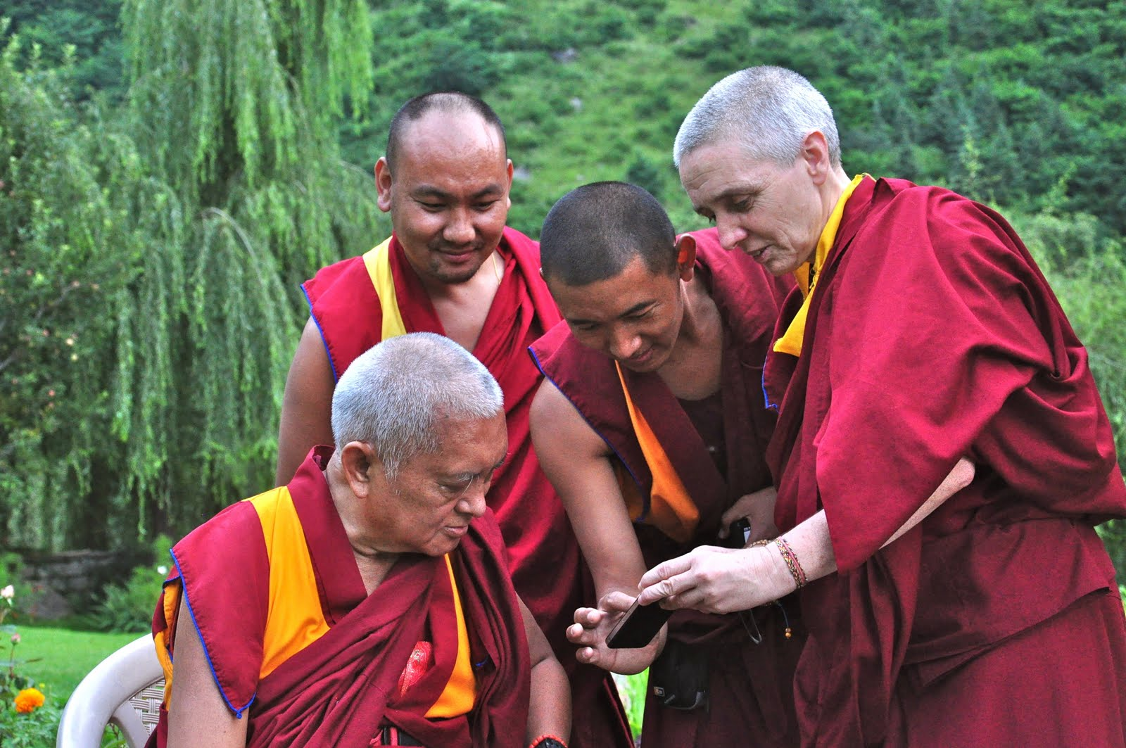 Rinpoche looking at a video of Sangpo hand-gliding. With Vens Tendar, Sangpo and Sarah in Manali, India, July 2013.