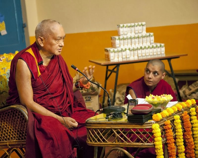 Lama Zopa Rinpoche teaching the children of Maitreya School and Tara Children's Home with Ven. Samten interpreting into Hindi, Root Institute, Bodhgaya, India, March 2014. Photo by Andy Melnic.