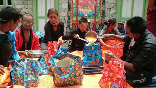 Charok Lama and other volunteers helping pack the packages of food to be delivered to Solu Khumbu villagers.