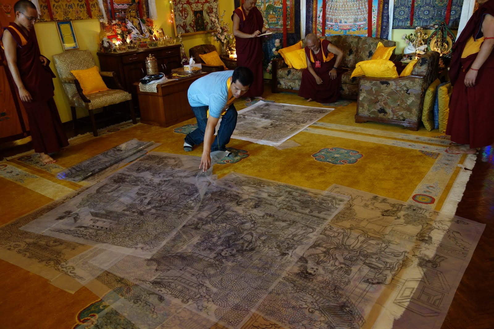 Rinpoche checking the art of the thangkas he is sponsoring: 21 Taras and The Eight Fearless Taras. There are 29 thangkas in total. Kopan Monastery, Aug 10, 2013. Photo: Ven. Roger Kunsang