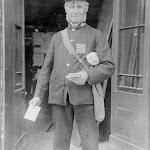 Mr Bellamy, the post man, outside the Old Forge
