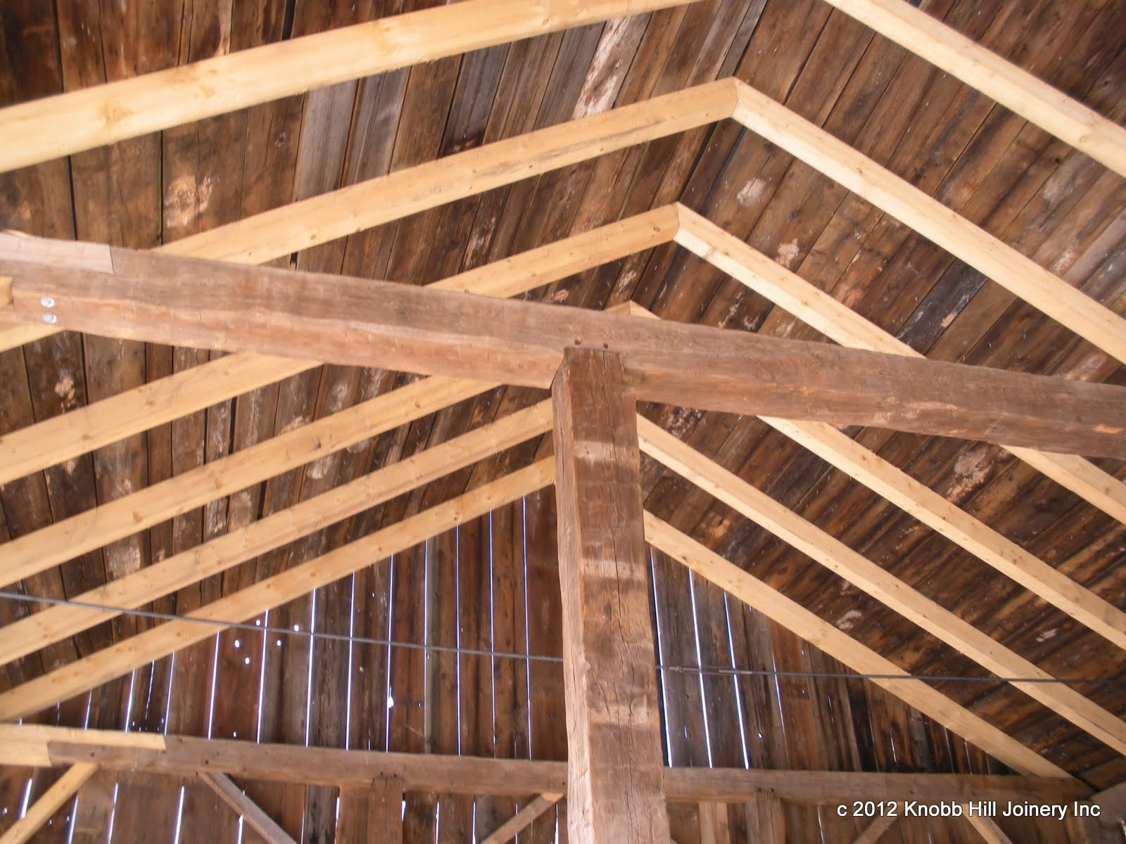 As all of the original rafters had been cut short, we chose to omit the ridge in order to reuse as much of the original rafter stock as possible.  Only 10 of 26 rafters were salvageable.