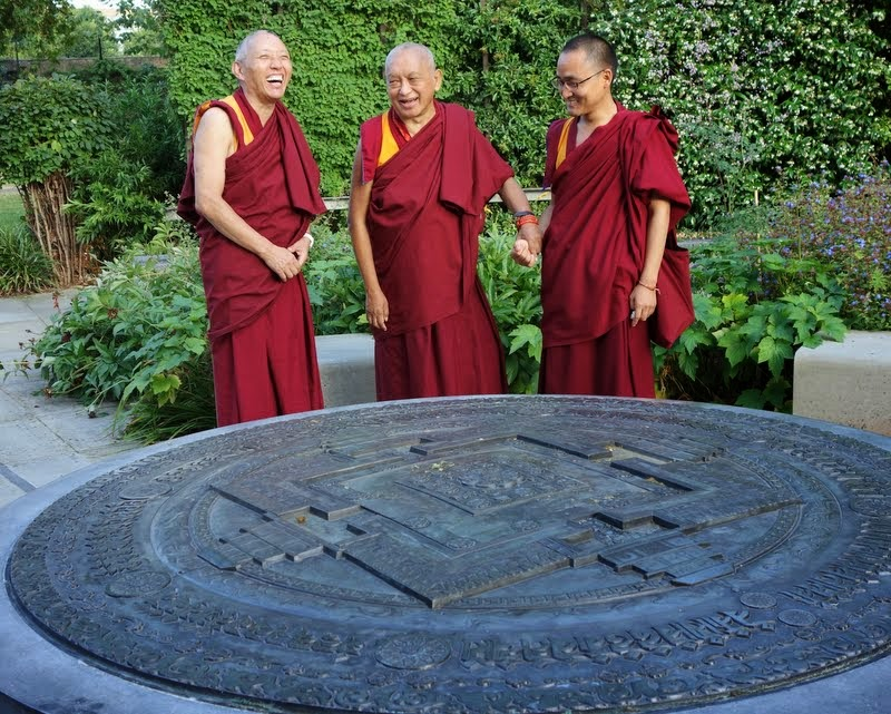 Lama Zopa Rinpoche with Jamyang Buddhist Centre resident teacher Geshe Tashi (left) and Ven. Sherab, Rinpoche's attendant, enjoying the Kalachakra mandala in the Tibetan Peace Garden near Jamyang Buddhist Centre, London, UK, July 2014. Photo by Ven. Roger Kunsang.