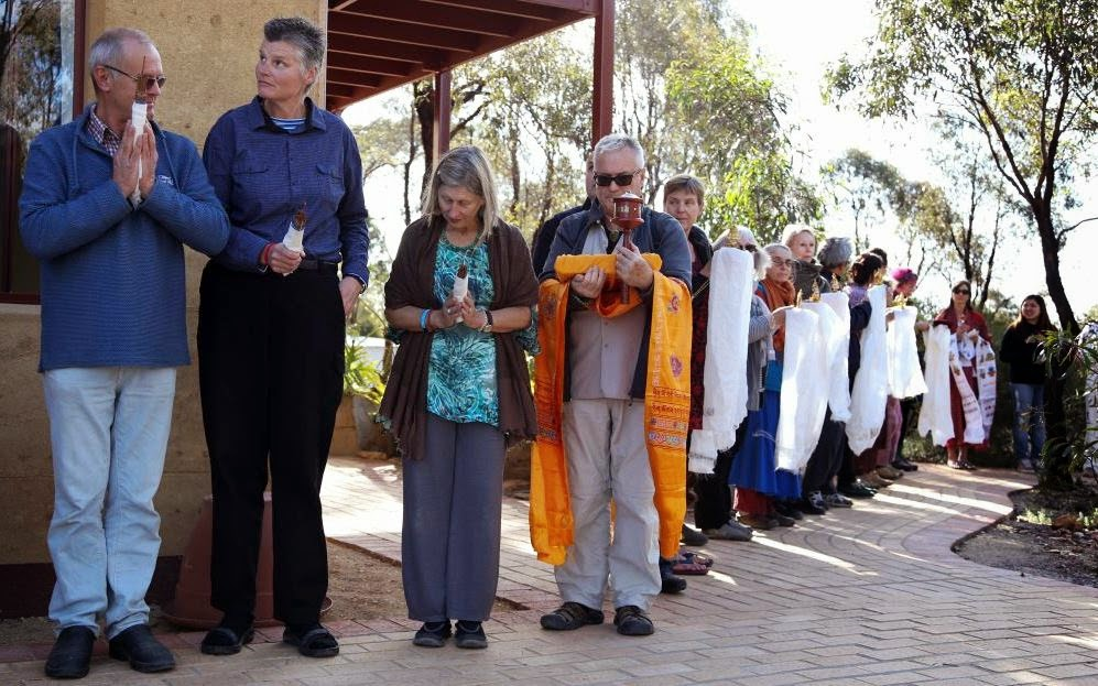 About 40 directors and SPCs from FPMT centers, projects and services lined up to lead Rinpoche from Thubten Shedrup Ling Monastery to the Great Stupa to continue the oral transmission of the Golden Light Sutra, Australia, October 2014. Photo by Ven. Thubten Kunsang.