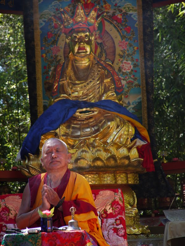Rinpoche making offerings during Ksitigharba statue at Land of Medicine Buddha