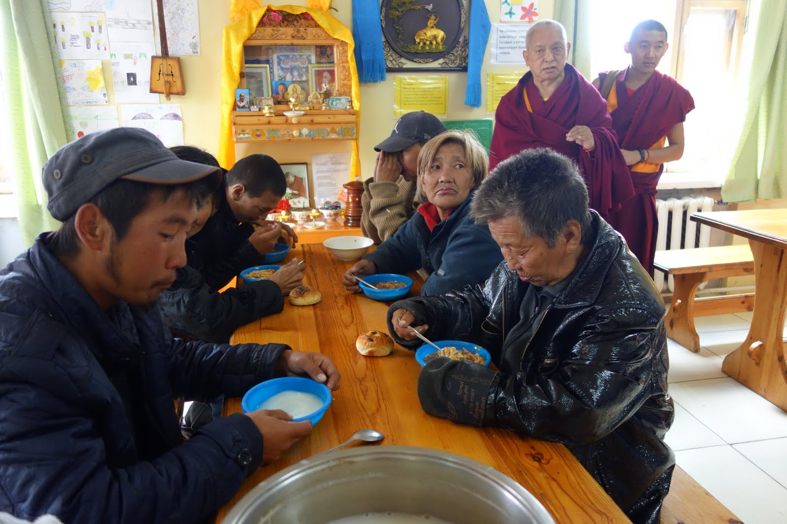 Mongolians eating at FPMT Mongolia's free soup kitchen for the poor and homeless where 60 to 90 meals a day are offered. September 2013 Photo: Ven. Roger Kunsang