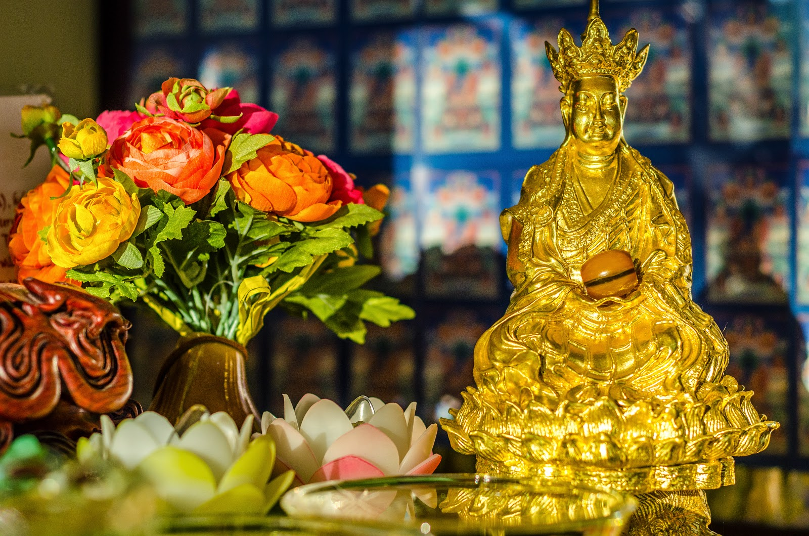 Ksitigarbha statue and extensive offerings at Kachoe Dechen Ling. Photo by Chris Majors.