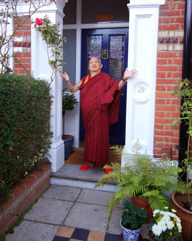"""Lama Zopa Rinpoche leaving the house where he was staying in London, next day was the flight London to the USA. ... Rinpoche is gesturing how much he enjoyed staying there and thanking the kind family who offered their house,"" shared Ven. Roger Kunsang, London, UK, July 2014. Photo by Ven. Roger Kunsang."