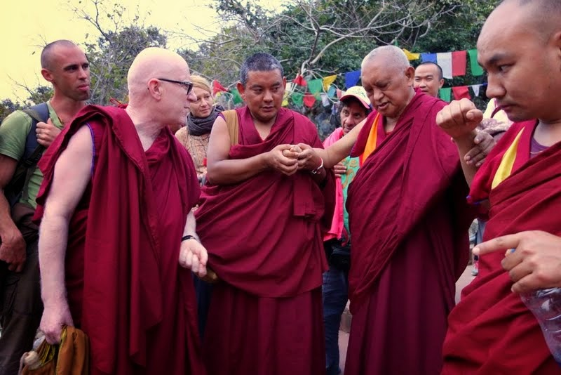 """Ven. Antonio Satta debating with Lama Zopa Rinpoche on the """"merely labeled"""" during the hike down from Vulture's Peak, India, March 2014. Photo by Ven. Roger Kunsang."""