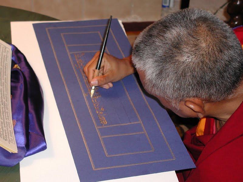 Writing the Sangatasutra in gold