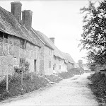 Stream Road, looking from junction with Pound Lane. 1907. Birthplace of Ted Keep. Most of the cottages seem to be timber-framed with brick in-filling, with thatched and one tiled roof, possibly dating to the 16th century. Reproduced by permission of English Heritage NMR.