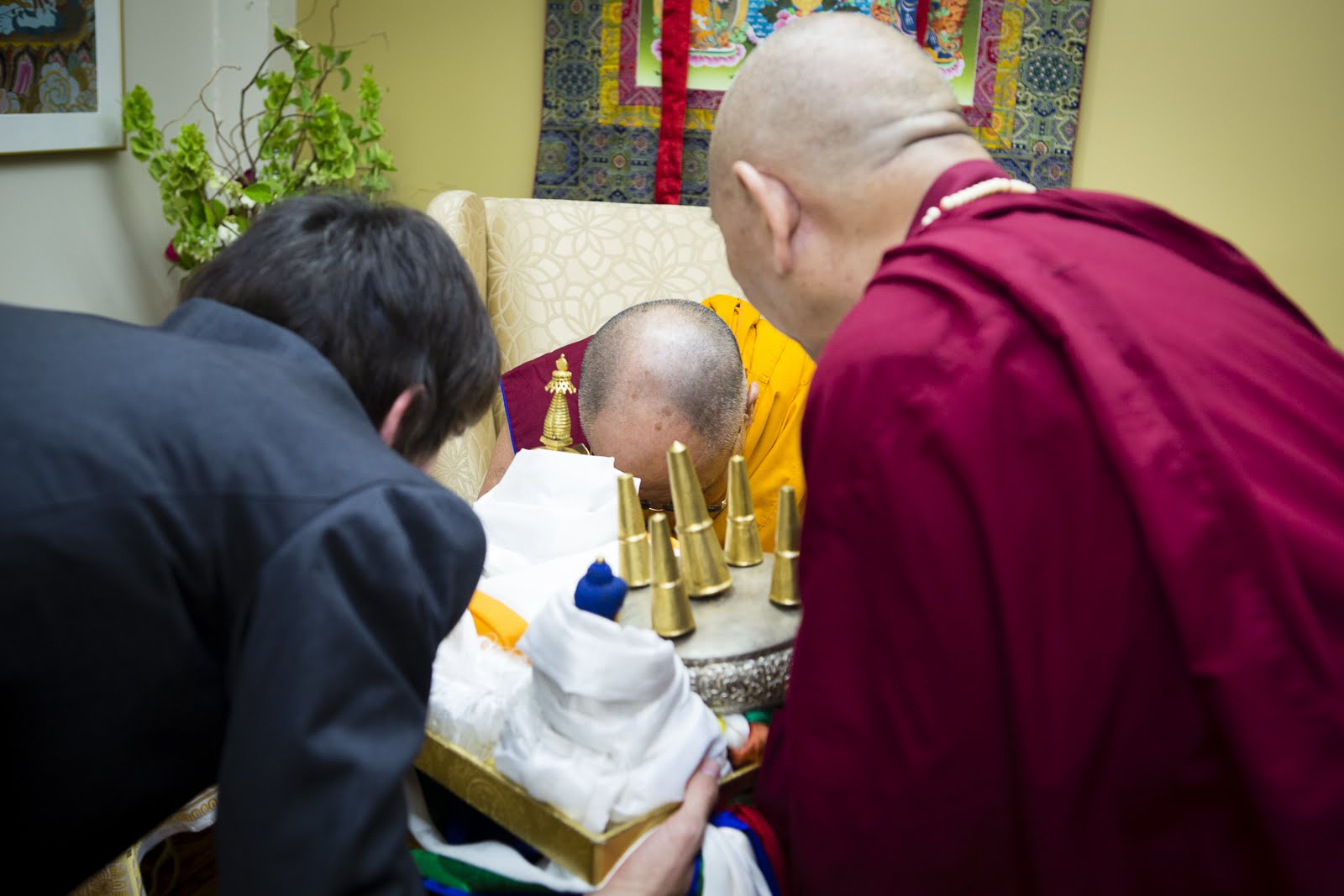 Ösel offering body, speech, and mind mandala to His Holiness the Dalai Lama. Photo by Leah Nash.