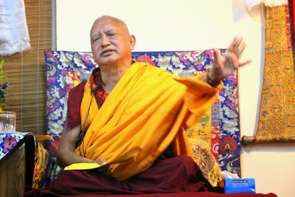"Rinpoche teaching at Choe Khur Sum Ling, Bangalore, India, March 2014. Photo by Ven. Thubten Kunsang. Rinpoche said: ""Milarepa had nothing and yet was always blissful! Many people have everything materially and are still unhappy. ..."""