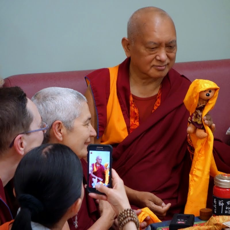 Lama Zopa Rinpoche having his photo taken with Teddy Tulku, Light of the Path, May 2014. Photo by Ven. Roger Kunsang.