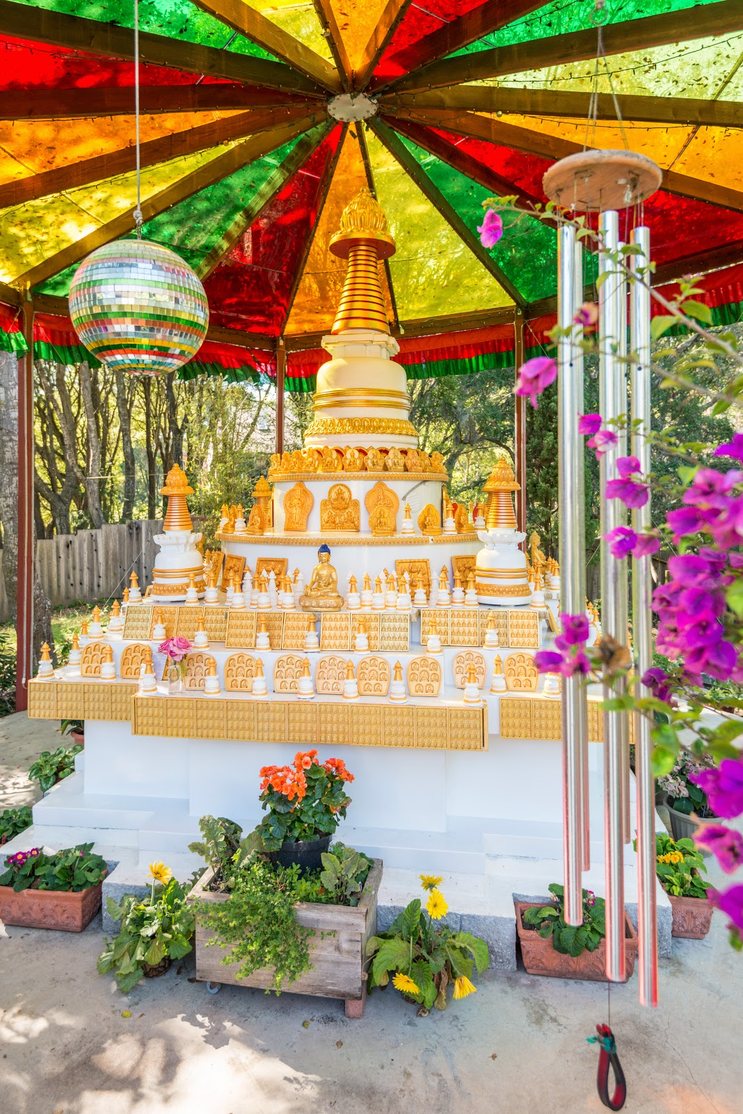 Stupa and extensive offerings at Kachoe Dechen Ling. Photo by Chris Majors.