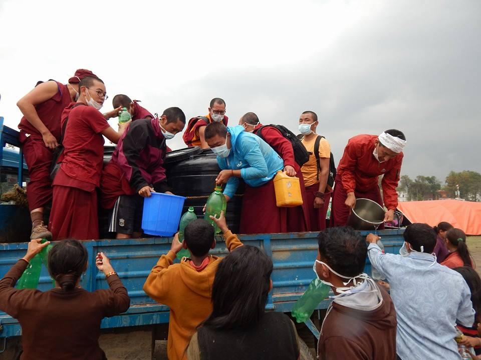 Kopan Monastery monks help distribute drinking water, Kathmandu, Nepal, April 2015. Photo thanks to Kopan Monastery School.