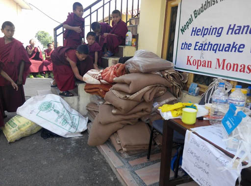 Supplies for distribution are collected at Kopan Monastery, Nepal, May 2015. Photo by Geshe Thubten JInpa.