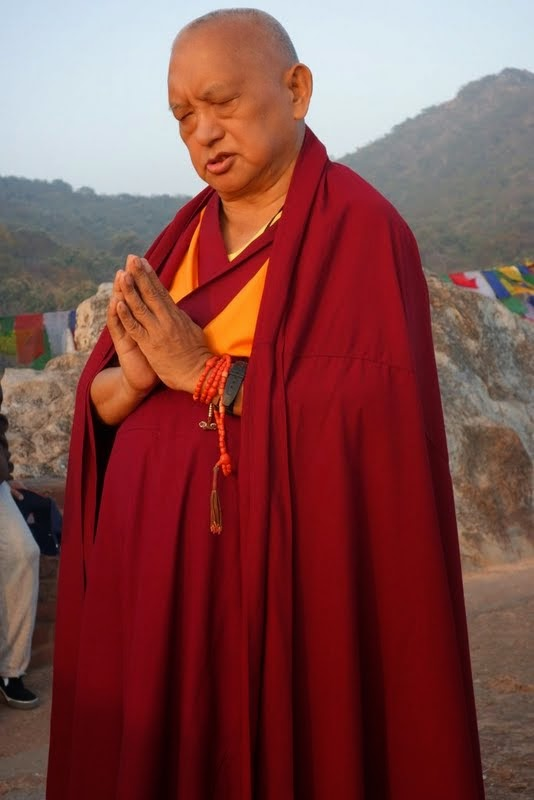 Lama Zopa Rinpoche does prostrations at Vulture's Peak, the site of Buddha's first teaching, India, February 2014. Photo by Ven. Roger Kunsang.