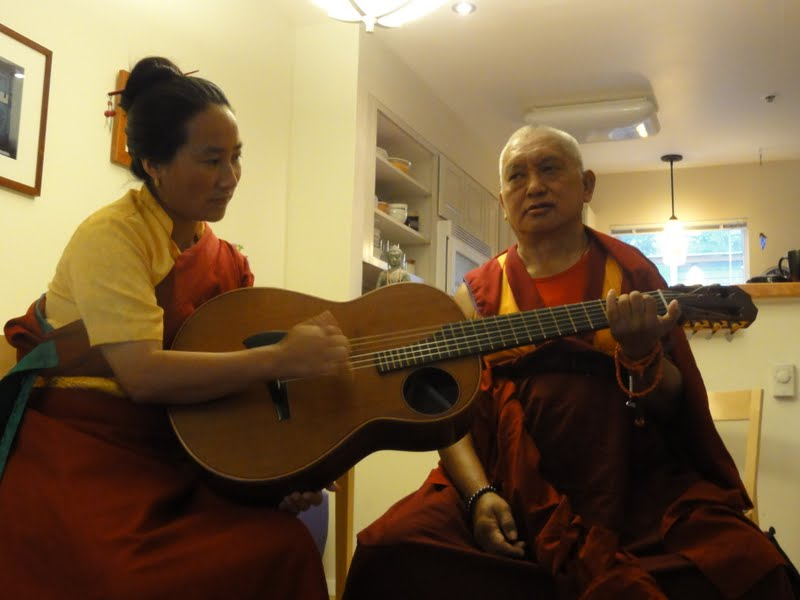 Khadro la and Lama Zopa Rinpoche putting the Wheel of Sharp Weapons to music
