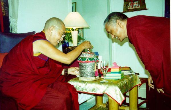Kirti Tsenshab Rinpoche and Lama Zopa Rinpoche with small prayer wheel.
