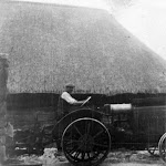 Barn at Middle Farm before fire. Daniel Greenough (Gwen's father) on tractor.