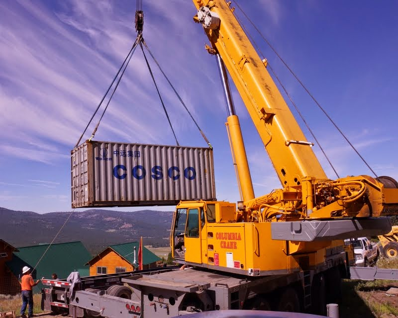 A crane lifts the container that holds the Amitabha Buddha statue that was shipped from Vietnam, Buddha Amitabha Pure Land, Washington, US, July 1, 2014. Photo by Merry Colony.