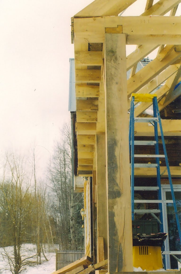 Detail of boxed in cornice framing and corner post joinery.