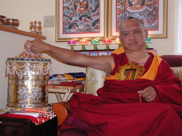 Lama Zopa Rinpoche with prayer wheel.