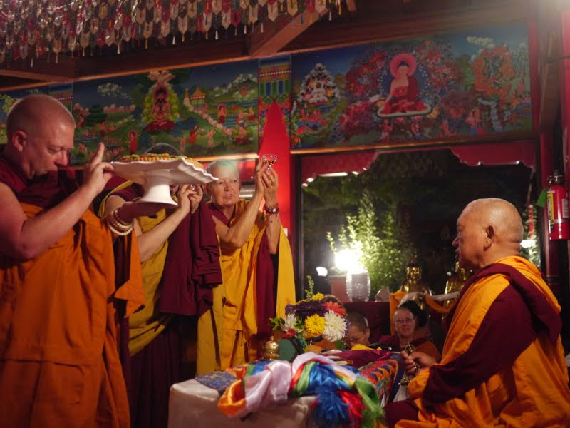 Sangha offering tsog to Rinpoche at the Wishfulfilling Temple at Land of Medicine Buddha