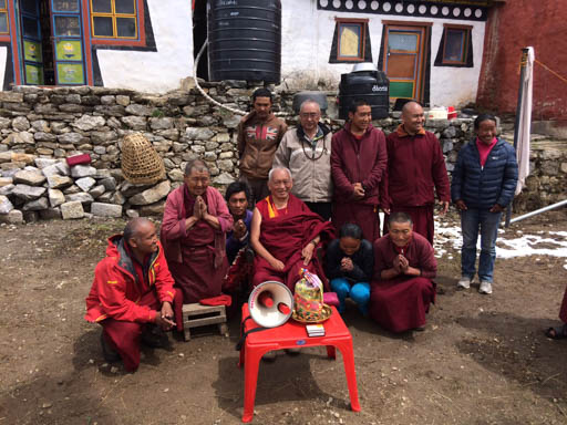 Lama Zopa Rinpoche with his sister Ani Ngawang Samten and brother Sangay Sherpa and other Sherpas at Lawudo Retreat Centre, Nepal, April 2015. Photo by Harry Sutton.