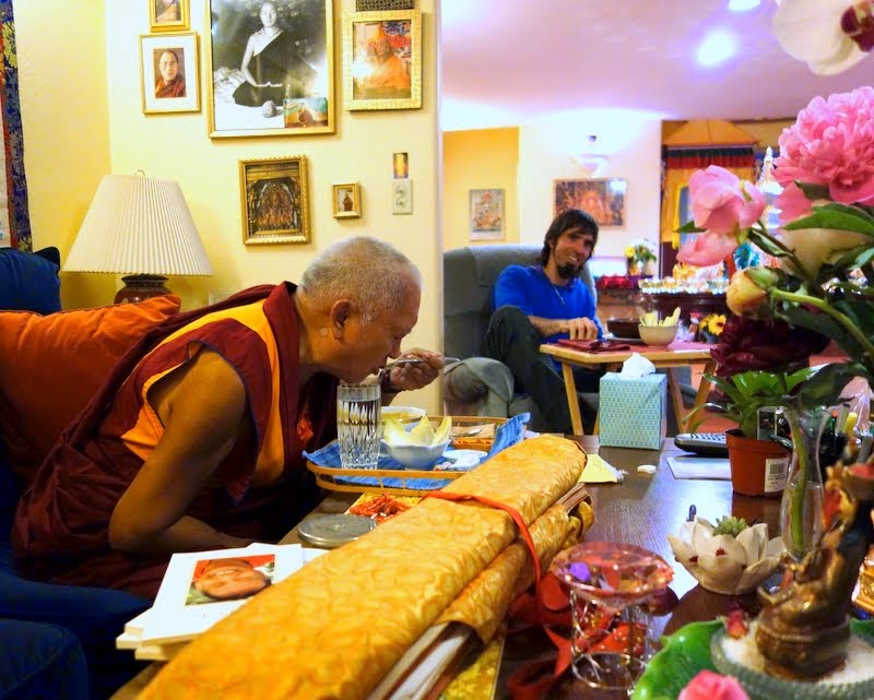Lama Zopa Rinpoche and Tenzin Ösel Hita sharing lunch, Kachoe Dechen Ling, Aptos, California, May 2014. Photo by Ven. Roger Kunsang.