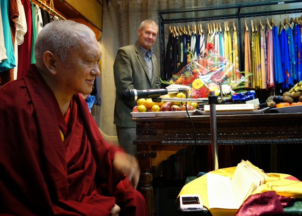 Lama Zopa Rinpoche teaching to the Nepali staff of Yak and Yeti on good heartedness, with  Marcel Bertels in the background, Kathmandu, Nepal, December 5, 2013. Photo by Ven. Roger Kunsang.