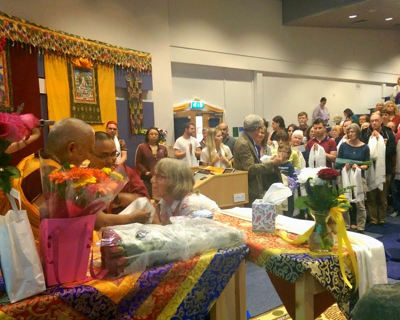 Lama Zopa Rinpoche being offered a khata by Jamyang Buddhist Centre Leeds director Wendy Ridley at the end of teachings, Leeds, UK, July 2014. Photo by Ven. Roger Kunsang.