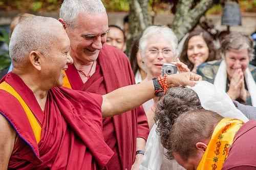 Lama Zopa Rinpoche greets students when arriving to Land of Medicine Buddha, California, September 21, 2013. Photo by Chris Majors.